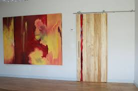 custom made modern barn door with red resin inlay by twochair