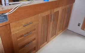 installing kitchen cabinets with lighter wood for open shelves and kitchen installing kitchen cabinets by integrating the door style well with the house part especially
