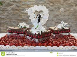 Wedding Cake Topped With Bride And Groom Figurines Stock Photo
