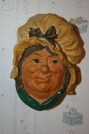 robin legend bosson chalkware wall plaque bosson heads