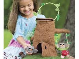 felt tree stump cottage carrier brings the magic of the forest to