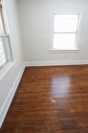 Laminate Flooring With Quarter Round Refinishing Old Wood Floors U2013 A Beautiful Mess