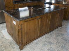pine kitchen islands knotty pine kitchen with black counter tops home design