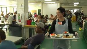 volunteers at joe s villages serve thanksgiving dinner to