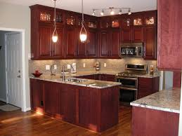 kitchen ideas cherry cabinets cherry kitchen cabinets with gray wall and quartz countertops