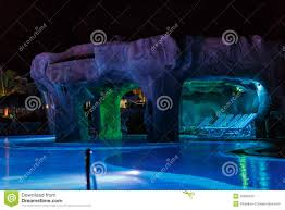view of swimming pool with various colorful beautiful lights and