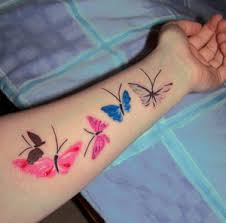 center arm tattoos with butterfly designs with