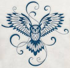 inky owl in flight admittedly this is a girly looking tat