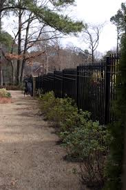 wrought iron fence installation on a hill grade or slope iron