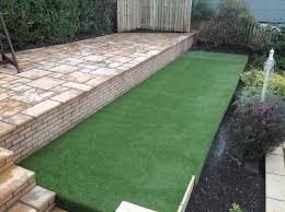 small very steep garden levelled and patio and artificial grass
