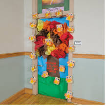 look who u0027s falling for a good book fall tree door decoration idea