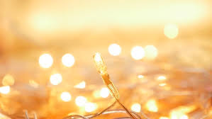 warm yellow slow motion linking golden color christmas background dot lights