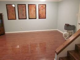 interior best basement floor paint colors with floated shelves in