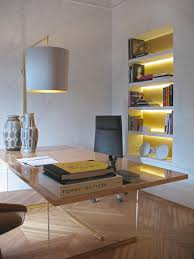 strip lighting in bookcase adds mood and task light in the office
