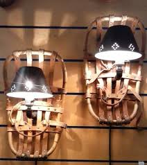 steampunk snowshoes upcycled into hanging wall sconces lamps