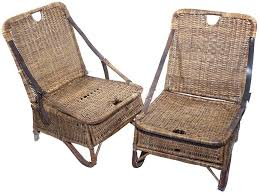 pair of folding wicker canoe chairs at 1stdibs