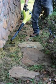 using available stones to build your attractive rock garden border