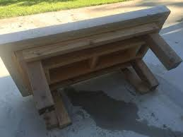 diy back yard coffee table top made of concrete with crushed wine