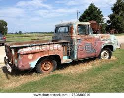 rusty pickup truck rusty old pickup truck stock photo royalty free 760680019
