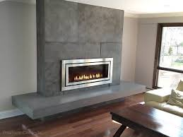 concrete fireplace surround with a regency fireplace and floating