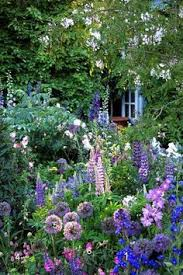small lush cottage garden by eva victoria1 love the soft looking