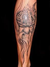 viking with sword tattoos on sleeve
