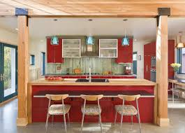 modern blue glass pendant lights over red gloss kitchen island