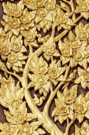 thai style golden tree carving handcraft with painted gold color