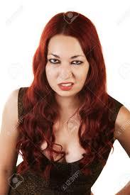 hispanic hair pics grumpy hispanic woman with red hair over white background stock