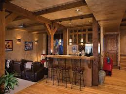 country home bar design idea with black metal stools and leather