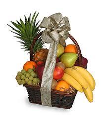 fruit basket gifts festive fruit basket gift basket in holbrook ma white flowers