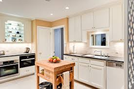 White Brick Backsplash Kitchen - marvelous butcher block cart in kitchen traditional with white