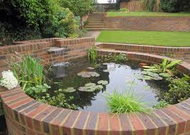 a raised pond is integrated into the garden structure ponds