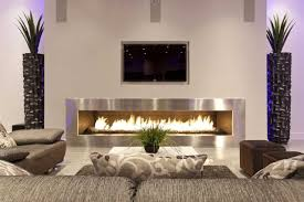 long silver steel block fireplace plus tv above placed on the
