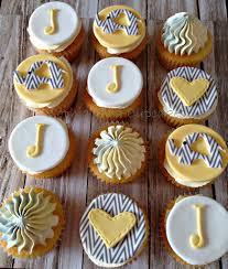 baby shower cupcakes with chevron elephants hearts and