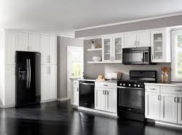 light brown kitchen cabinets with black appliances decorating around black appliances