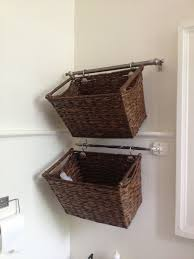 Hanging Baskets For Bathroom Storage Cut A Curtain Rod And Hang Wicker Baskets For Easy