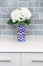 best 25 glass subway tile backsplash ideas on pinterest glass gray and white kitchen white quartz countertop kitchen gray kitchen cabinets glass subway