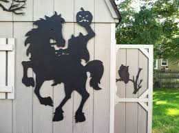 halloween street background headless horseman halloween silhouettes yard decor shadows