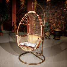 cool design of hanging wicker chair made of rattan material with