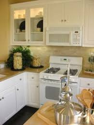 Cream Colored Kitchen Cabinets With White Appliances Antique White Cabinets With White Appliances For The Home