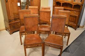 a rare set of 8 oak antique dining chairs by arthur simpson of