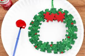 puzzle christmas wreath craft project for kids large family table