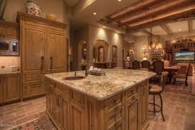 Mediterranean Kitchen Ideas - mediterranean kitchen with limestone tile u0026 raised panel in