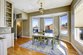 green dining room dining room in light olive color with hardwood floor blue rug