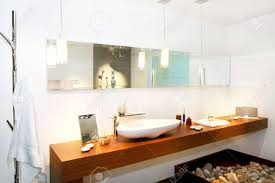 interior of wooden bathroom with long mirror stock photo picture