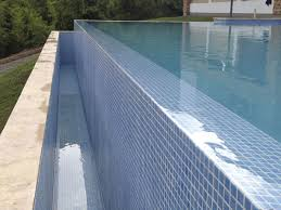 stone and glass design concepts for your swimming pool pure