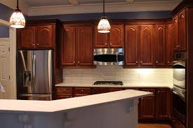 kitchen with brown cabinets kitchens with brown cabinets and white backsplash