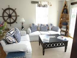 small living room with captain wheel wall decor and boat bookcase