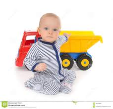 toddler toy car child baby boy toddler happy sitting with big toy car truck stock